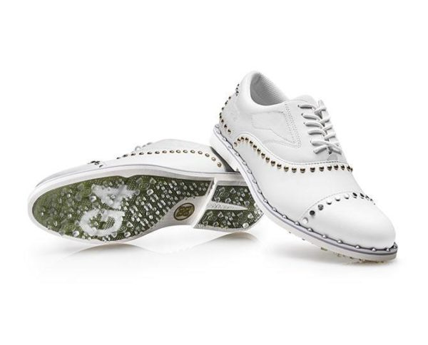 As stylish as it is comfortable, the Gallivanter IV.0 golf shoe combines an athletic fit with premium waterproof leather in signature G/FORE colourways. This style features metallic silver and gold stud details on the Blush pink welt and upper. Custom designed by G/FORE's team of footwear experts, the Gallivanter IV.0 boasts an ultra lightweight sole coupled with a bespoke cleat design for optimal on-course traction. This shoe sports a washable and anti-microbial, triple density foam cushion footbed for superior comfort along with Comfort System Technology which allows airflow to feet and provides the ultimate massage for your soles.MATERIAL & CARE100% Waterproof Smooth Full Grain LeatherPadded Interior For Extra Comfort100% Anti-Microbial Mesh Cotton Lining Inhibits Odor